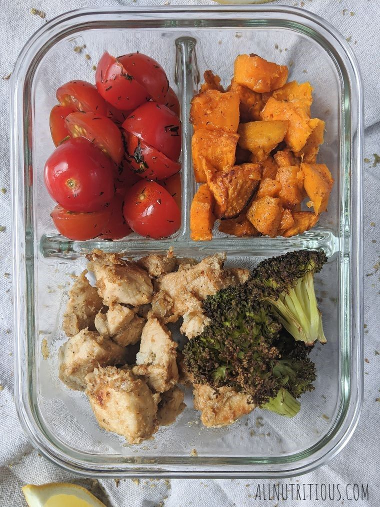 chicken meal prep with tomatoes and sweet potatoes