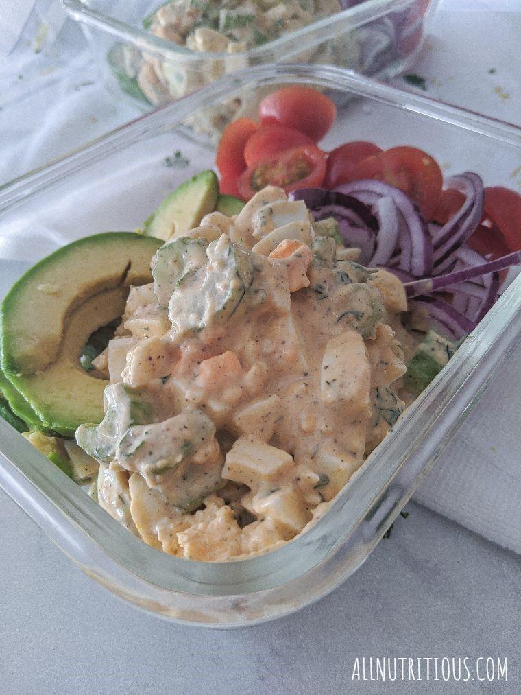 side shot of meal prep bowl with egg salad