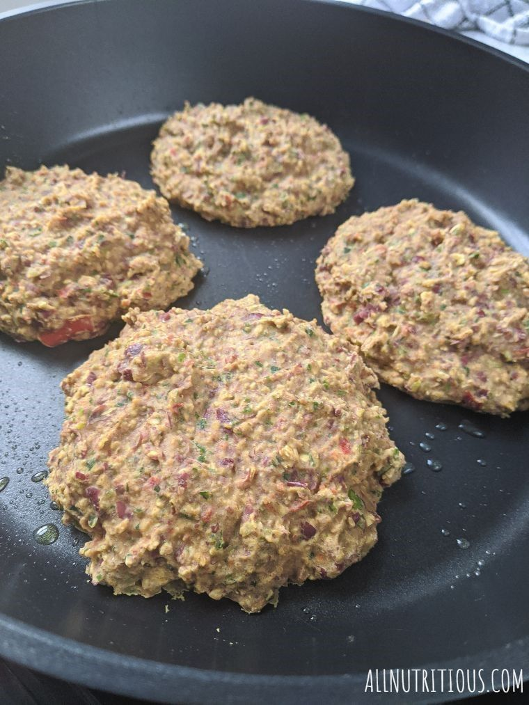 vegetarian burger patties in a frying pan