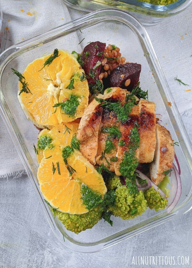 orange with beets and chicken in a food container