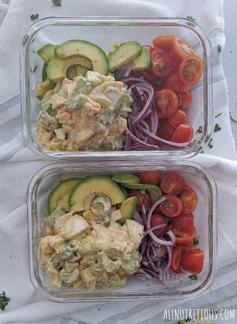 vegetarian egg salad in containers with veggies