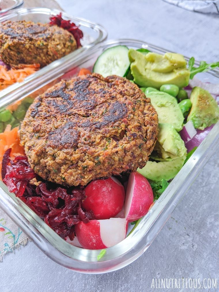 bean burgers with veggies in food containers