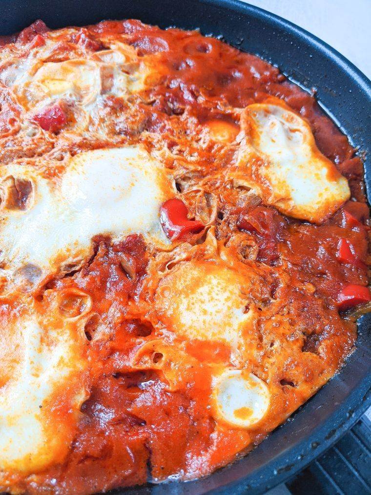 eggs cooking in shakshuka