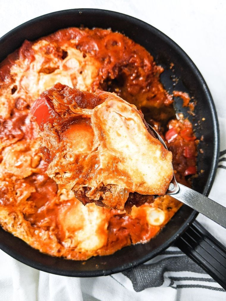 serving spoon of shakshuka