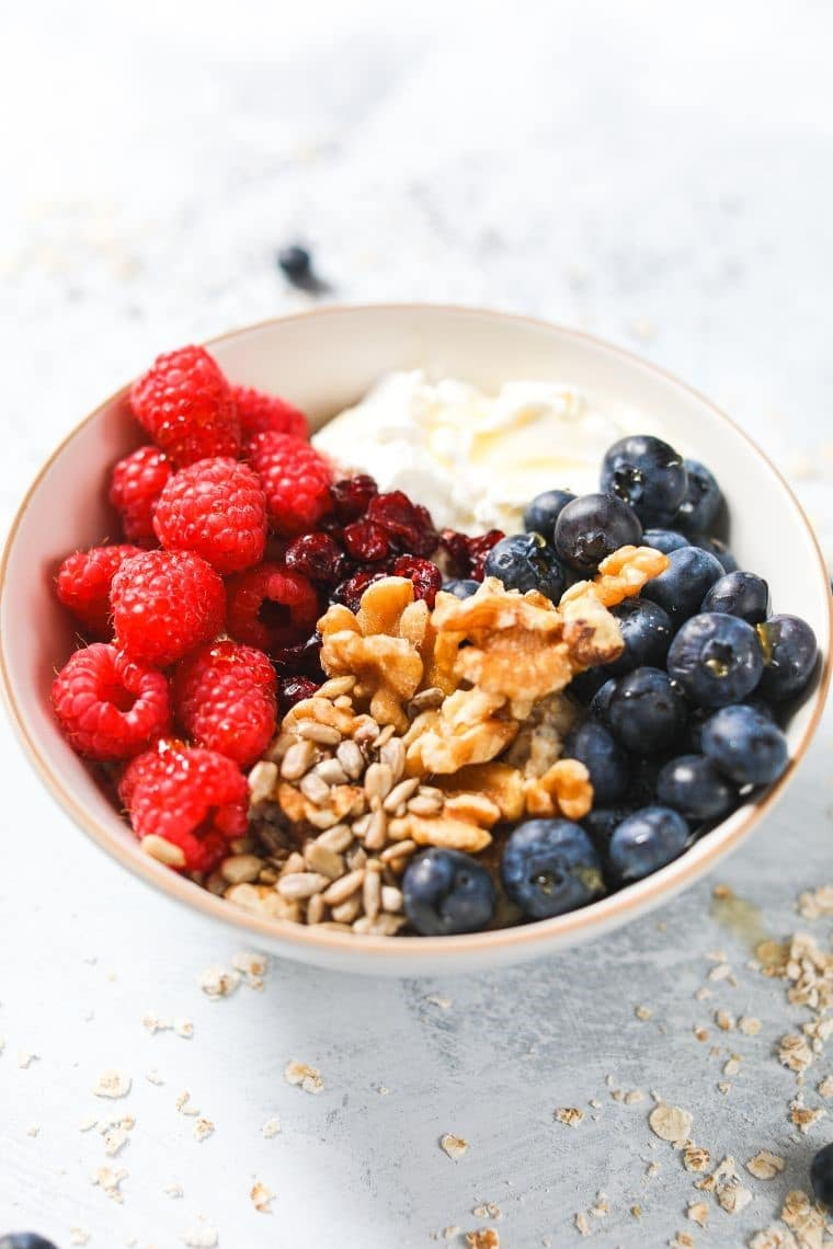oatmeal with seeds and berries in bowl
