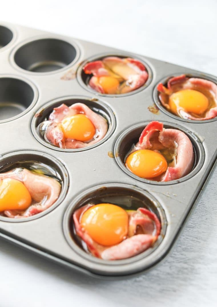 cracked eggs with bacon in muffin tin