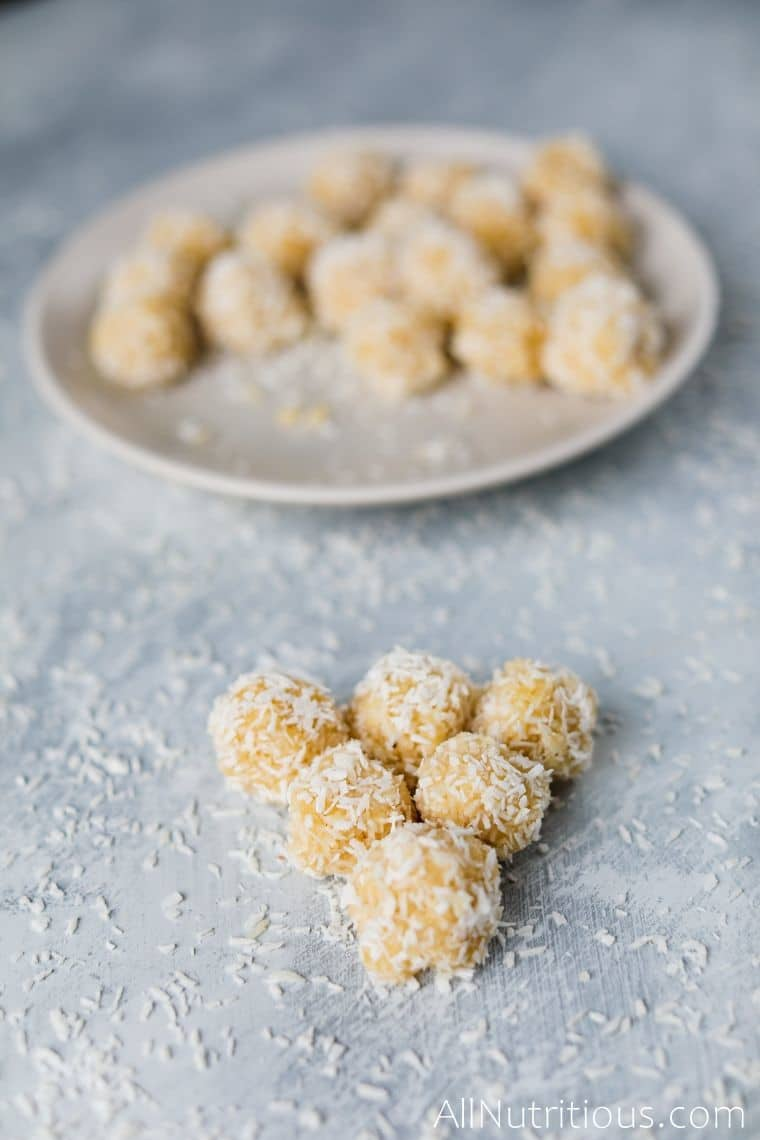 five coconut balls infront of plate