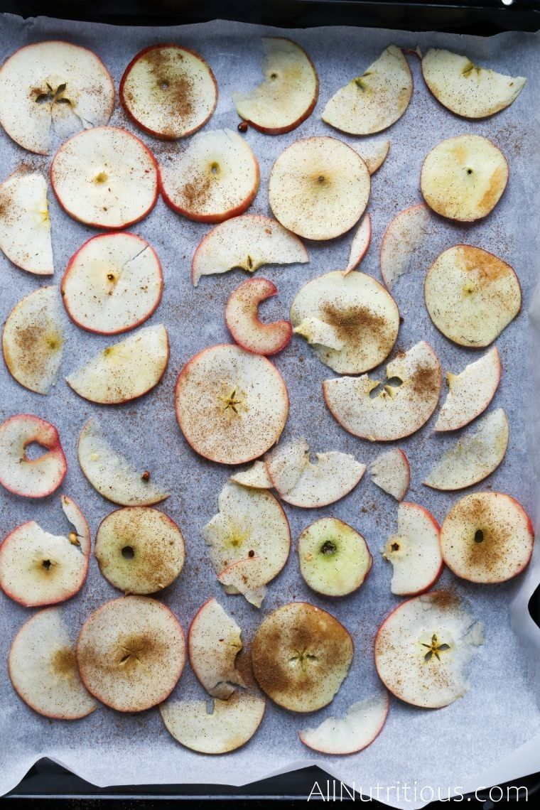 apples on sheet with cinnamon