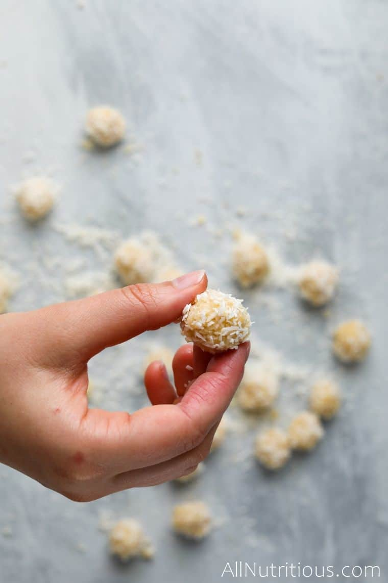 hand with coconut protein ball