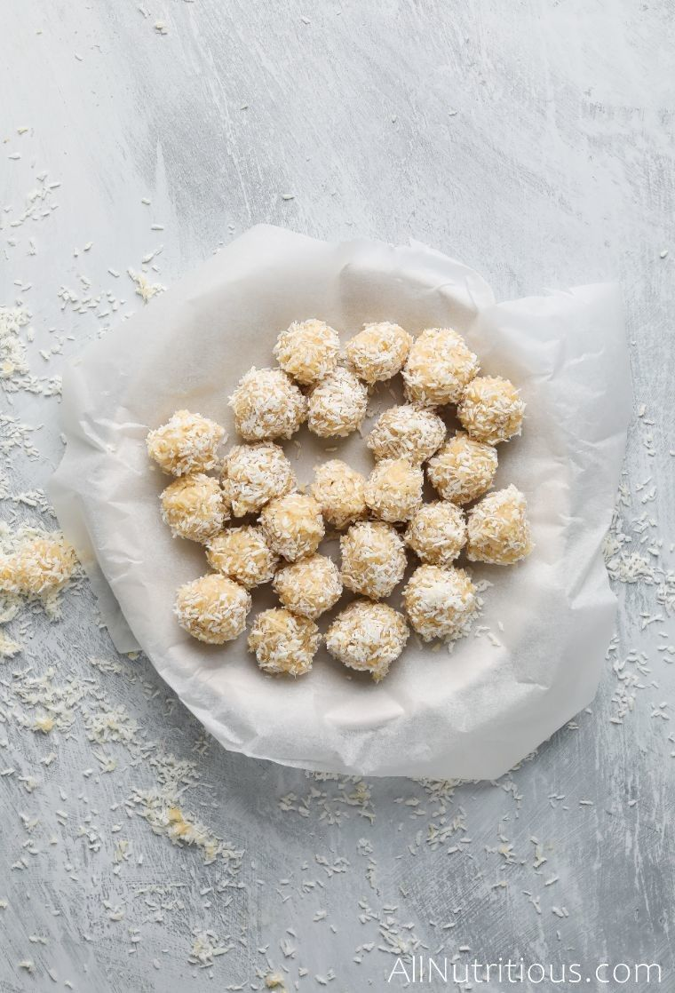 coconut balls on parchment paper