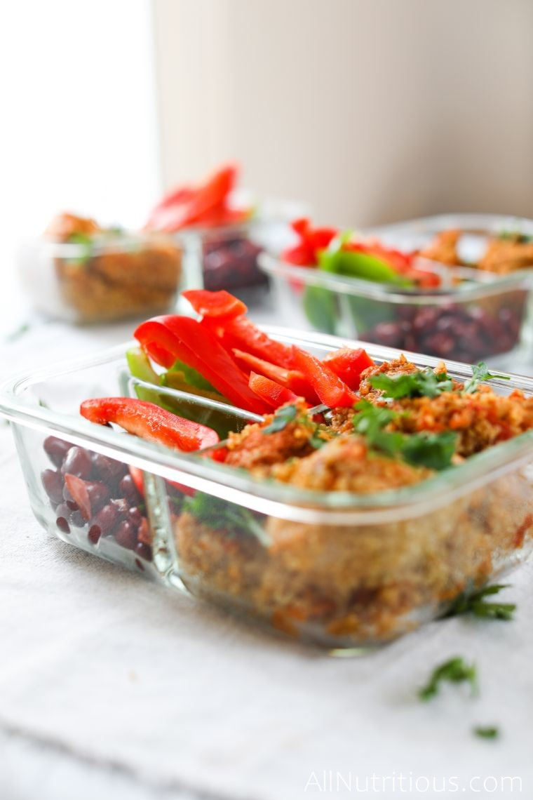spicy chicken divided into meal prep containers