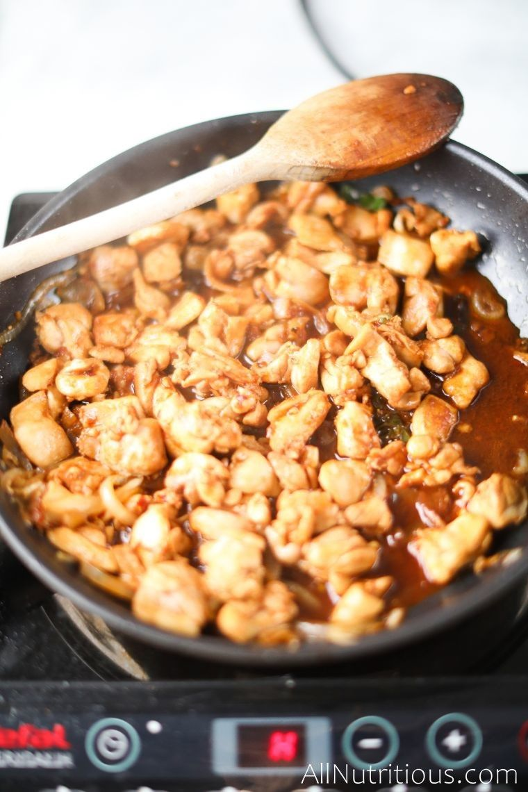 soy sauce and chicken in skillet