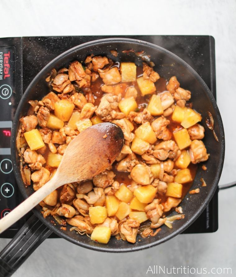 cooking pineapple chicken on pan