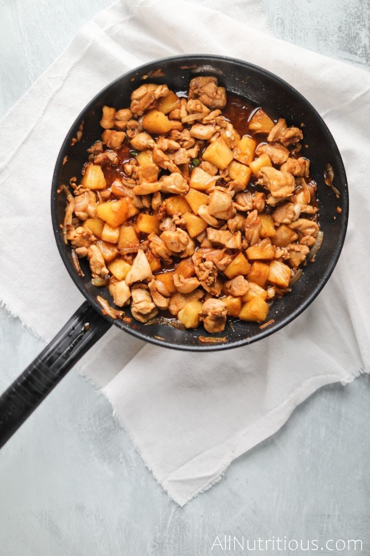 pineapple and chicken in skillet