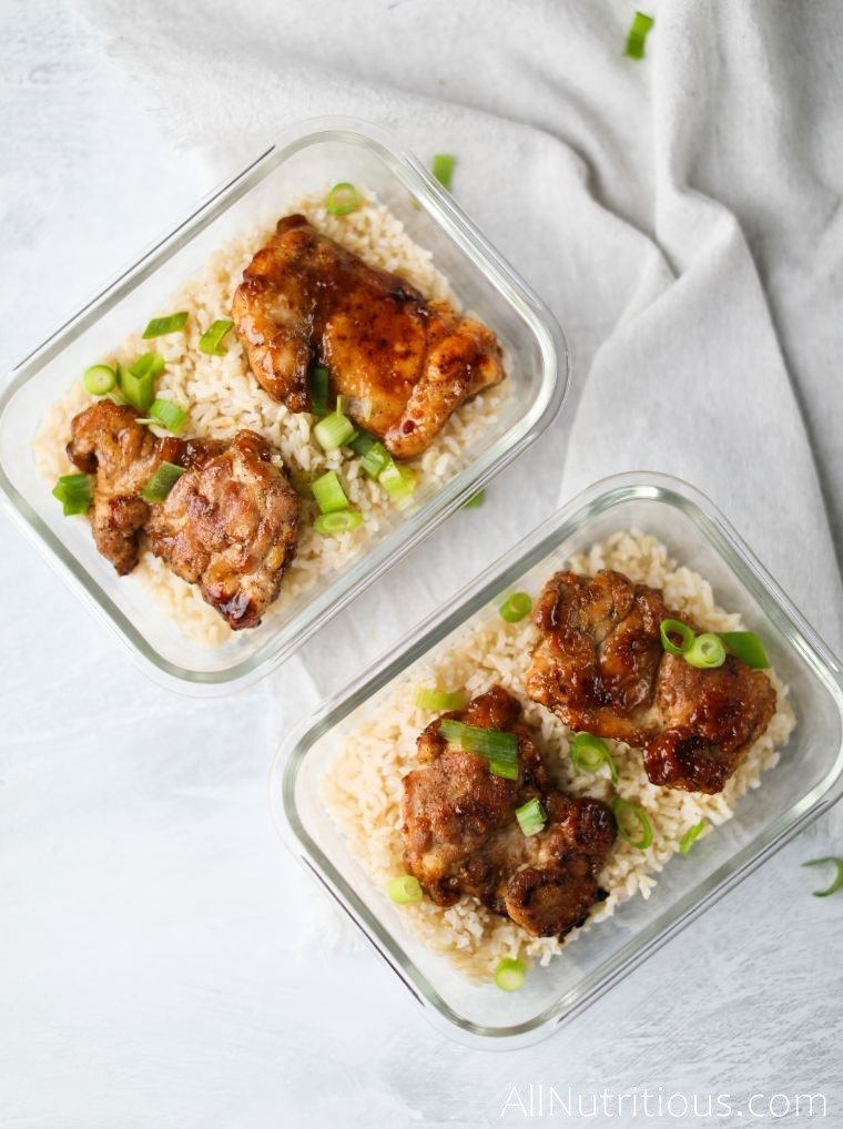 glass meal prep containers with rice and chicken
