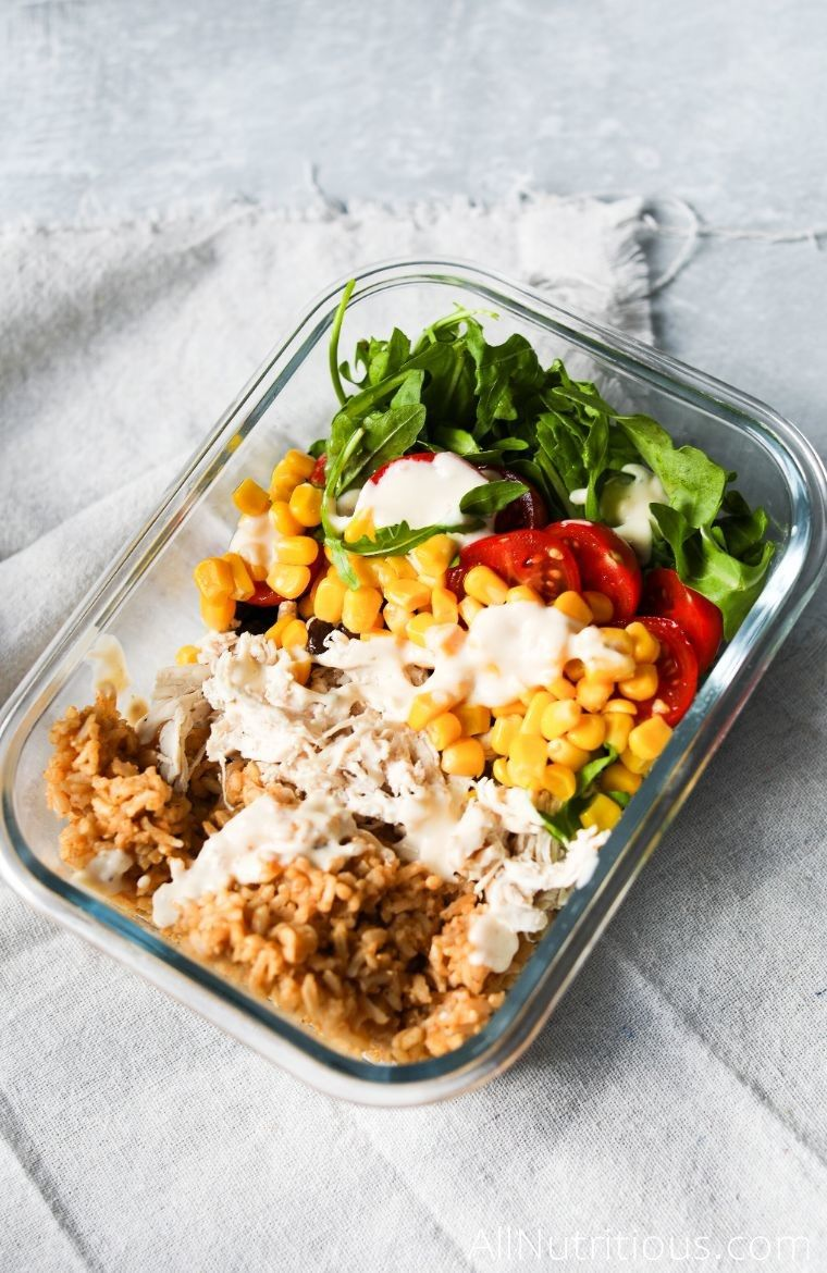 healthy burrito bowl with tomatoes and corn