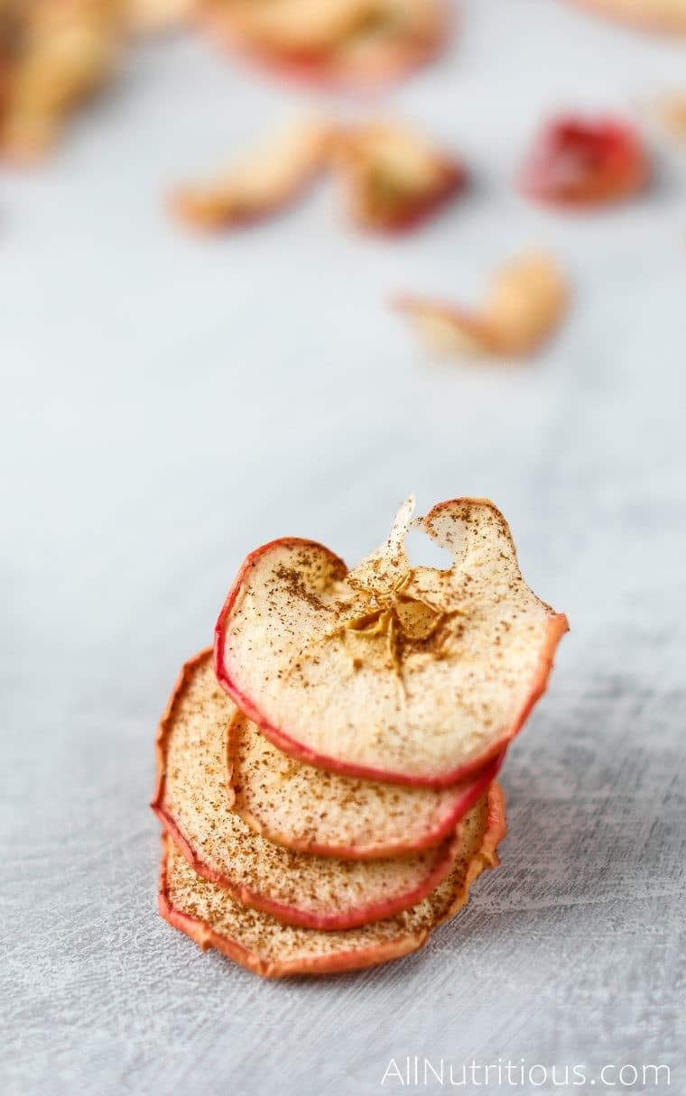 stack of apple chips in oven