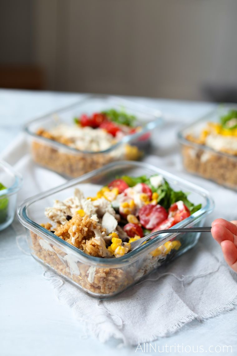 forkful of spicy rice burrito meal prep