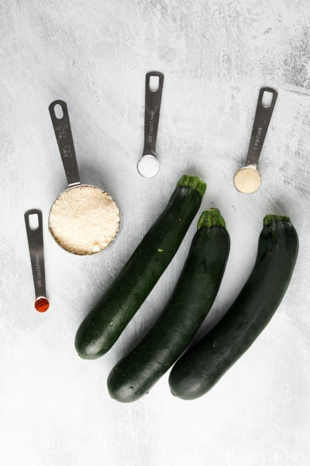 whole zucchini with spice spoons