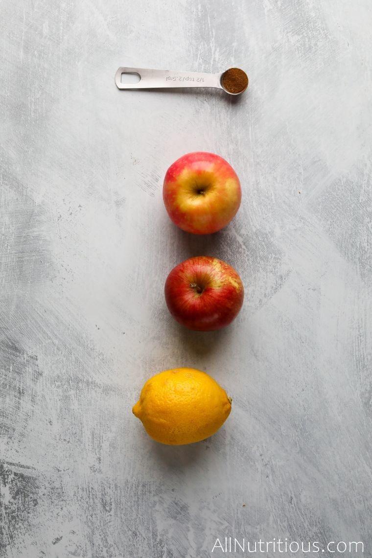 whole apples, lemon, and cinnamon