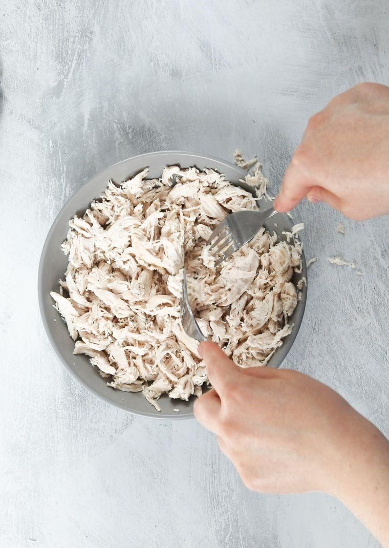 shredding chicken with fork
