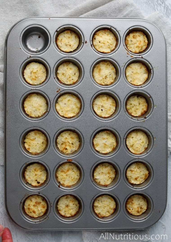 baked cheesy cauliflower bites inside the mini muffin tin
