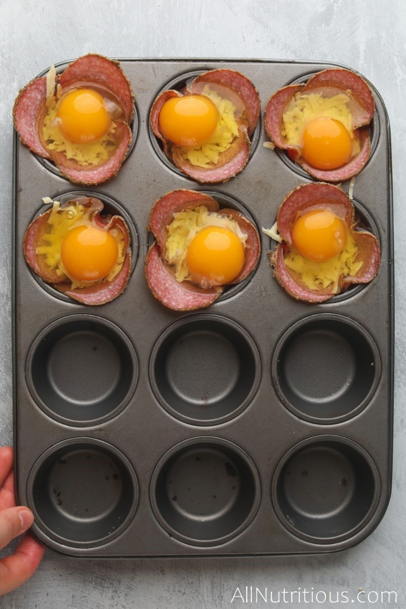 cracked eggs in salami cups