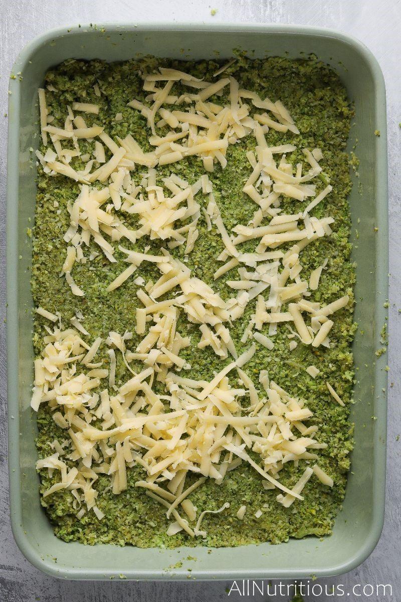 shredded cheese on broccoli