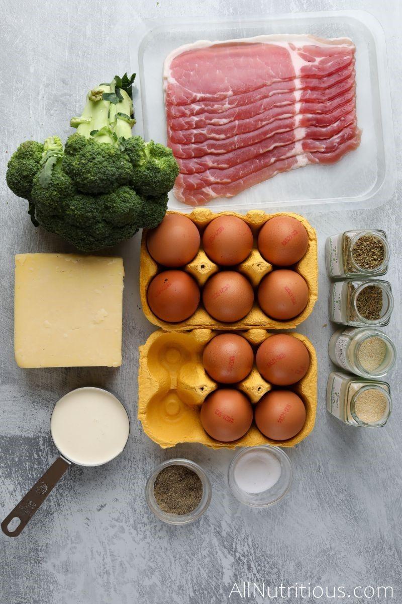 bacon strips, broccoli, spices, egg carton and cheese