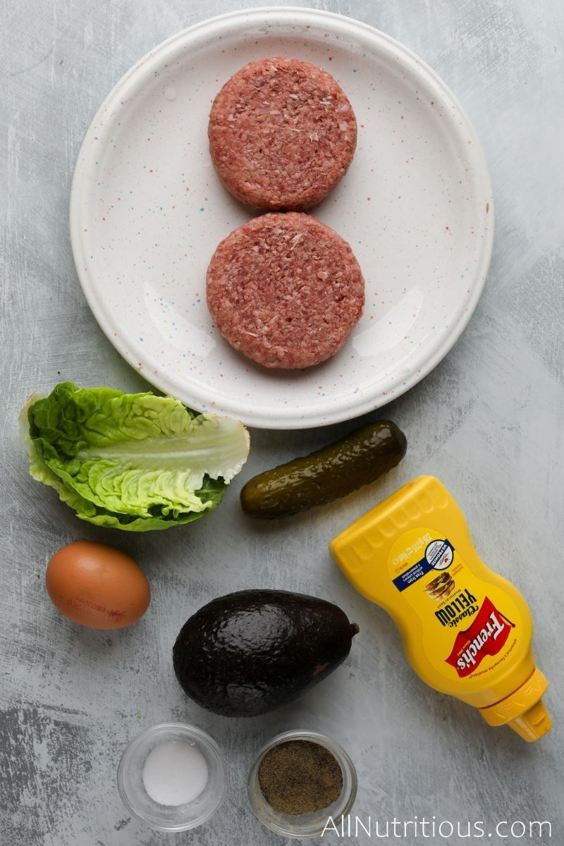 burger patties, mustard, avocado, egg, lettuce, and spices