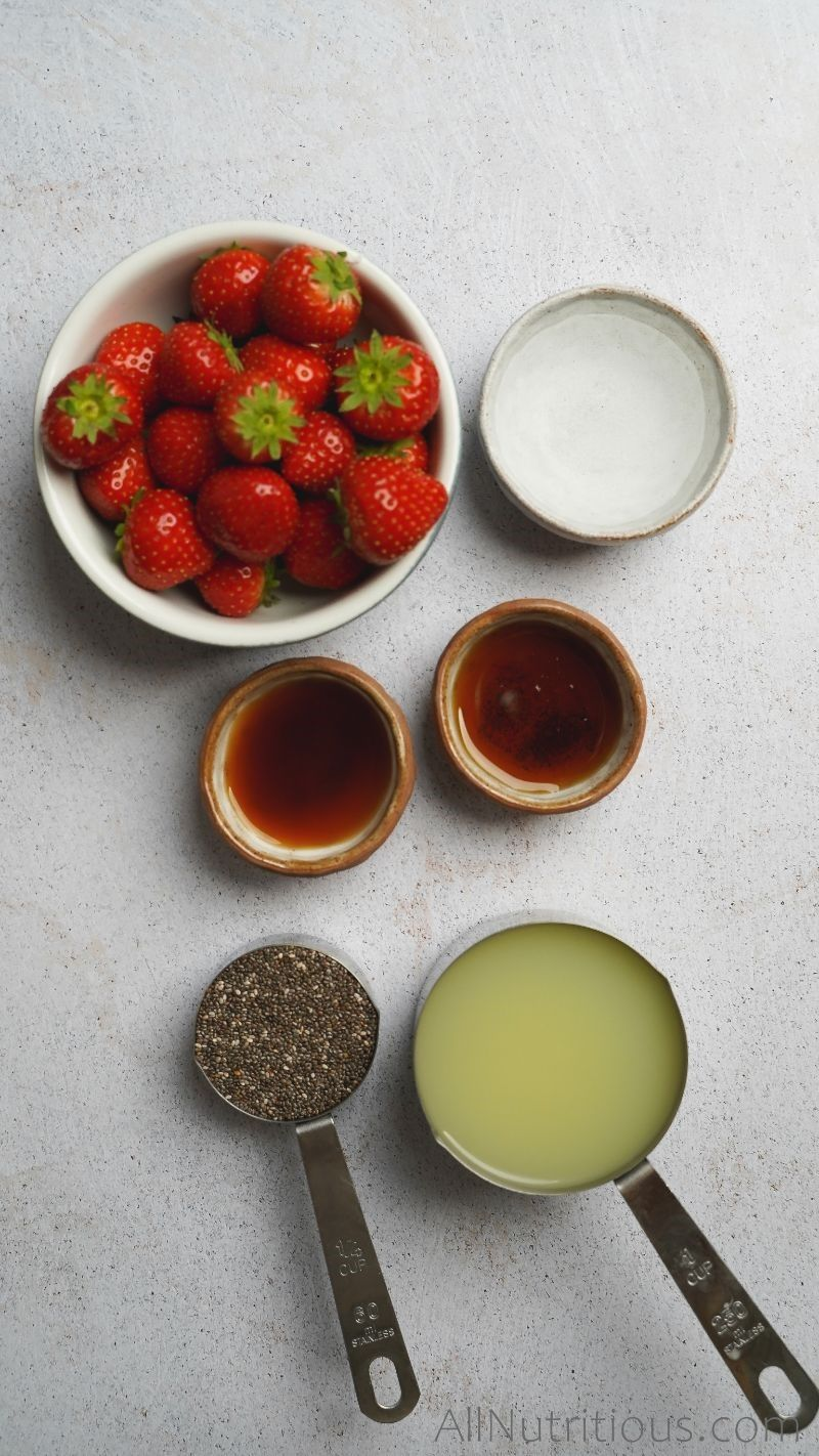 strawberries and ingredients in measuring cups