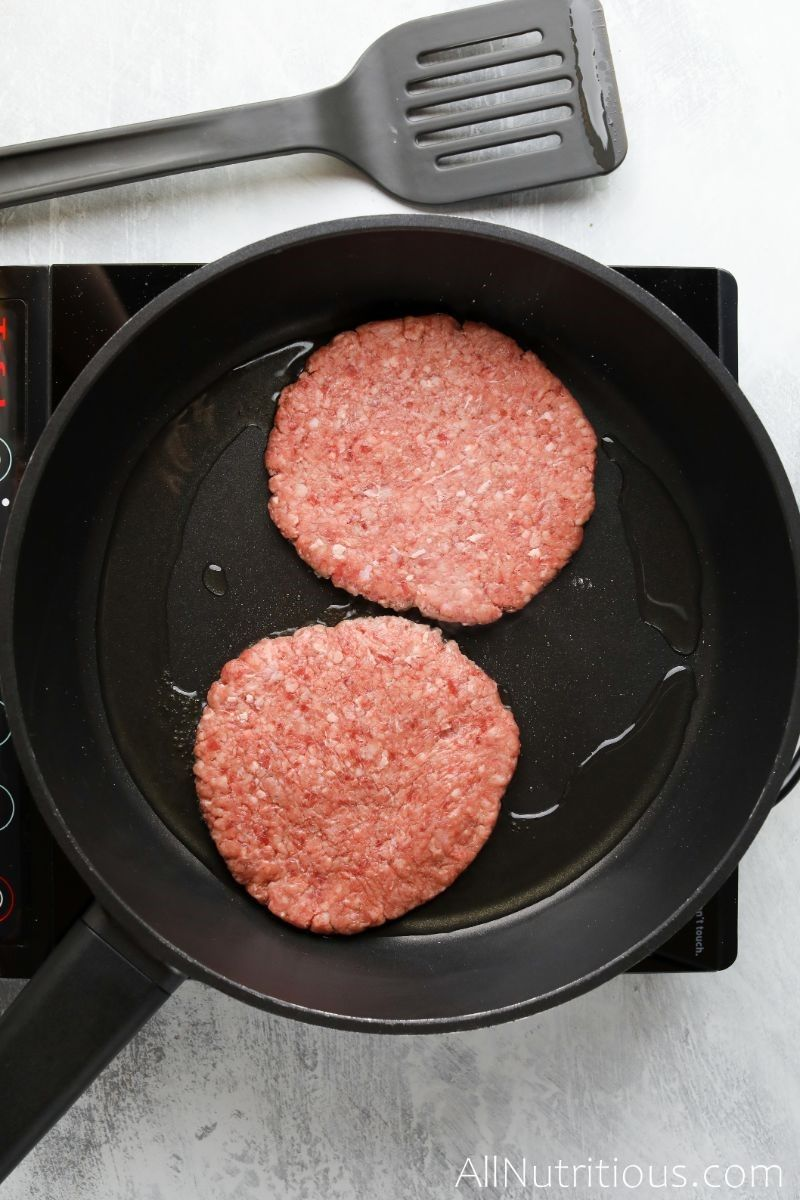 beef patties in pan with oil
