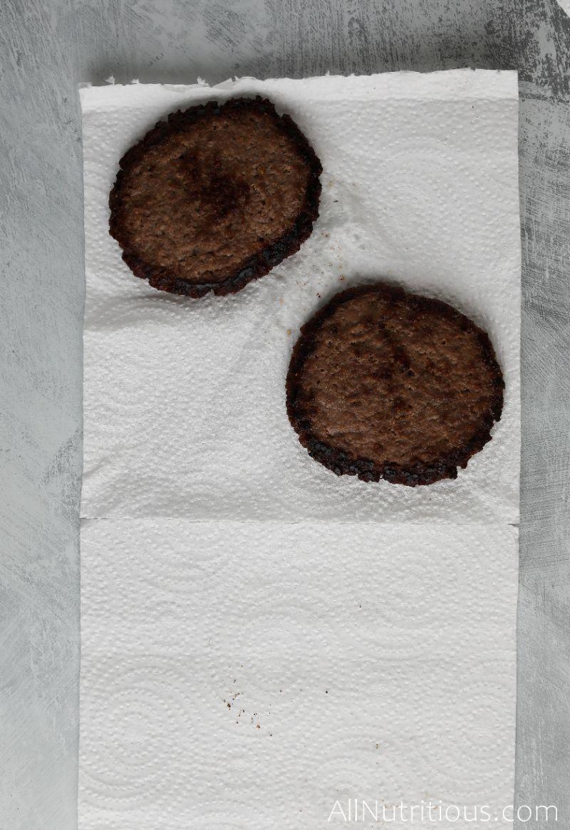 crispy burger patties on paper towel