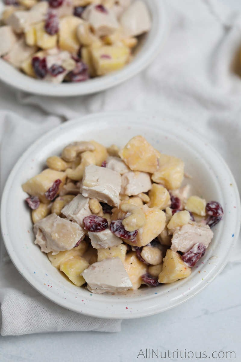 bowl of chicken salad with apples