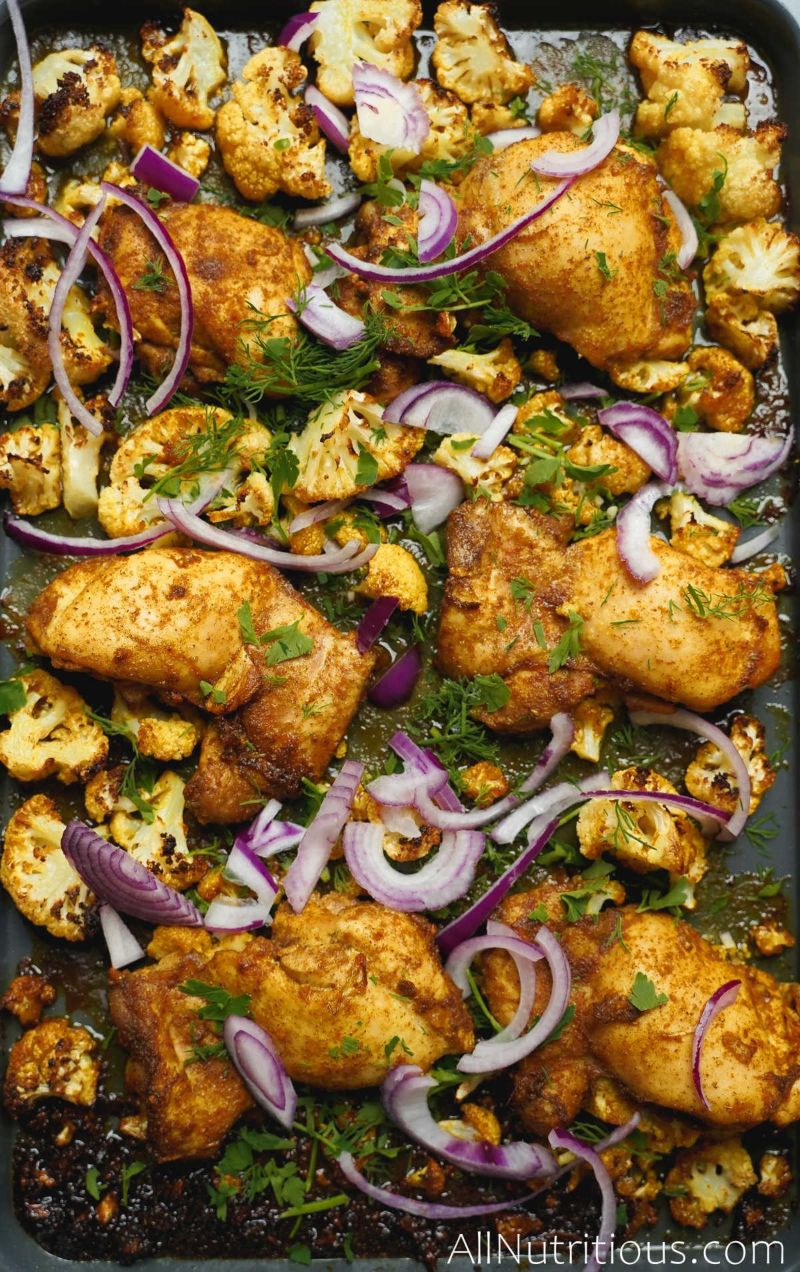 cooked chicken thighs and cauliflower with red onion