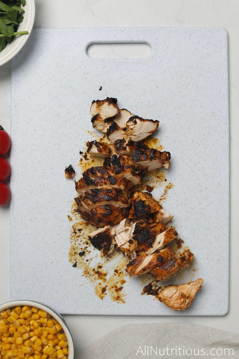 sliced chicken on cutting board