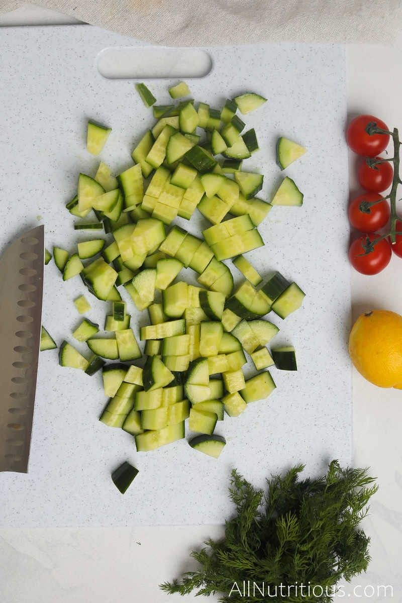 chopped cucumbers on cutting board