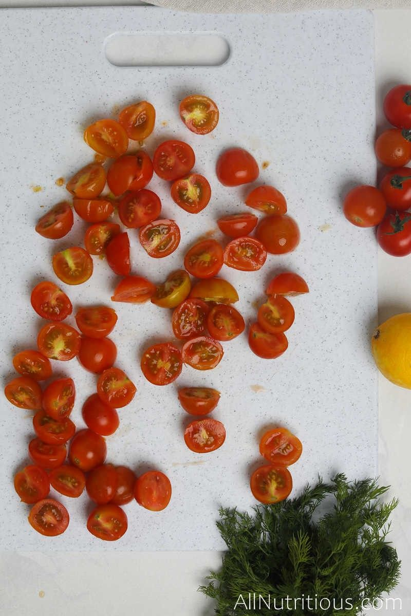 chopped cherry tomatoes on cutting board