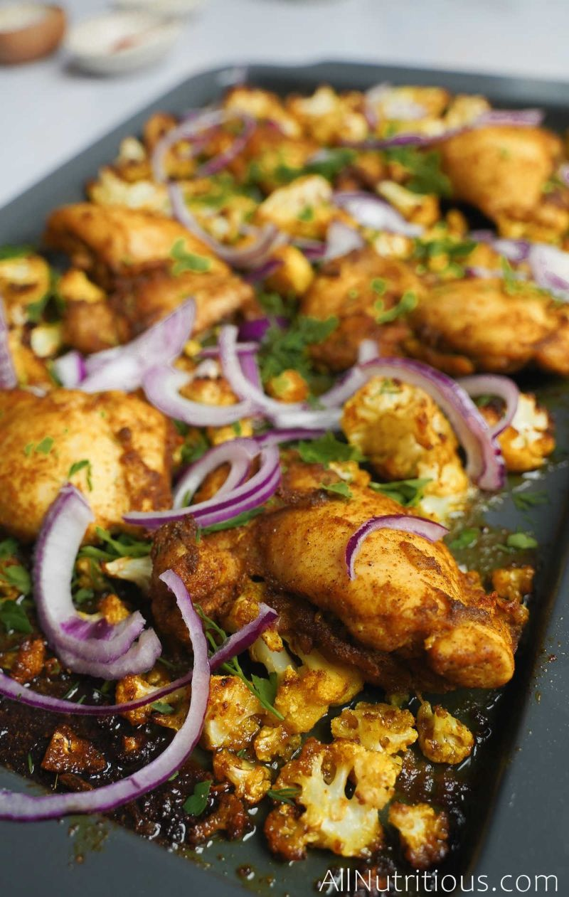 sheet pan chicken and red onions