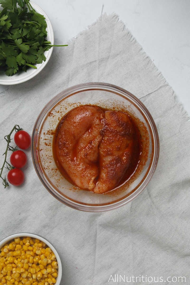 chicken breasts in marinade bowl