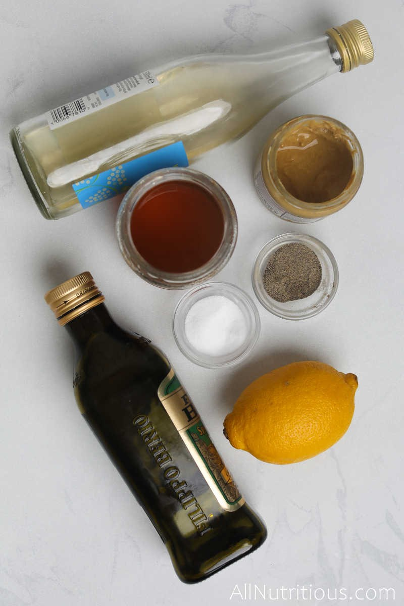 a lemon, bowls of spices and oil