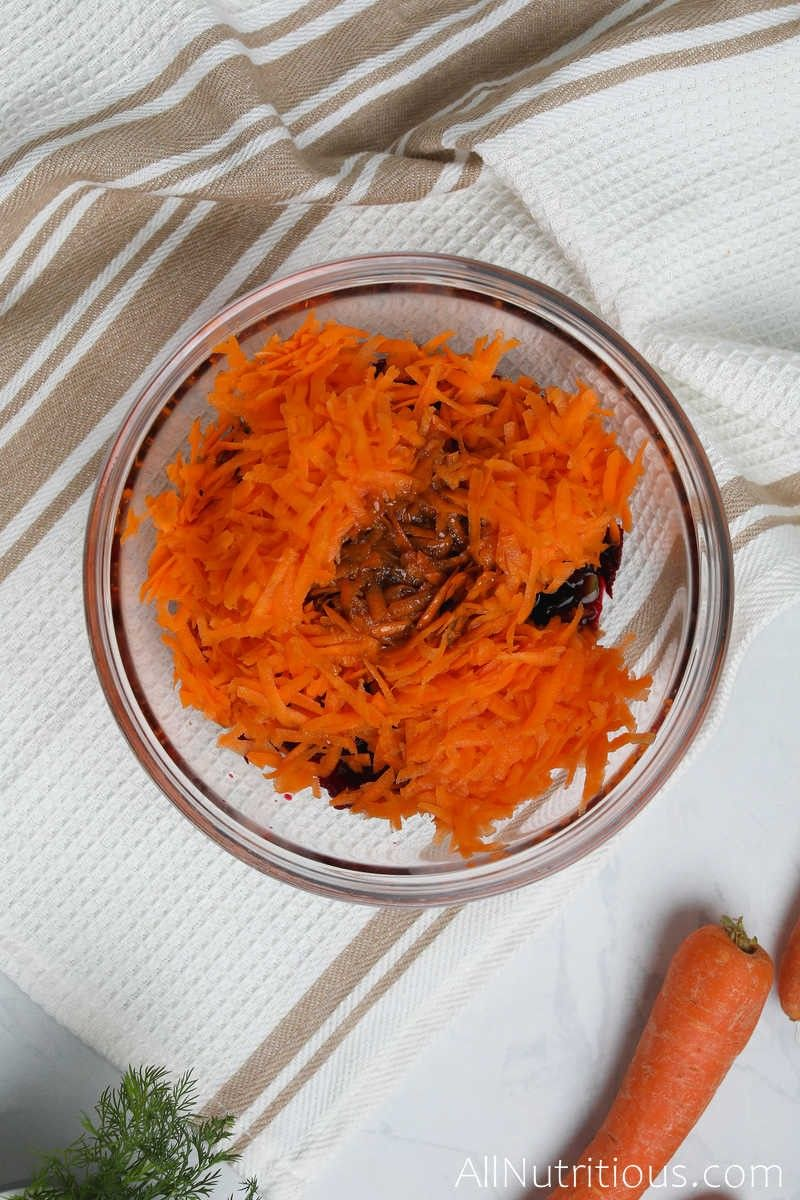 carrots, dressing and beets in bowl