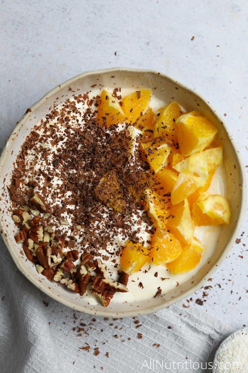 yogurt with pecans, oranges and dark chocolate