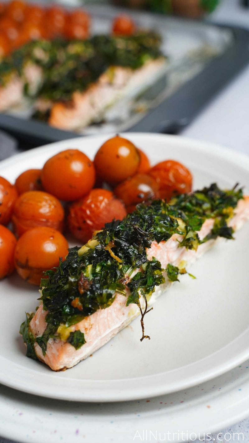plate with herb crusted salmon and tomatoes