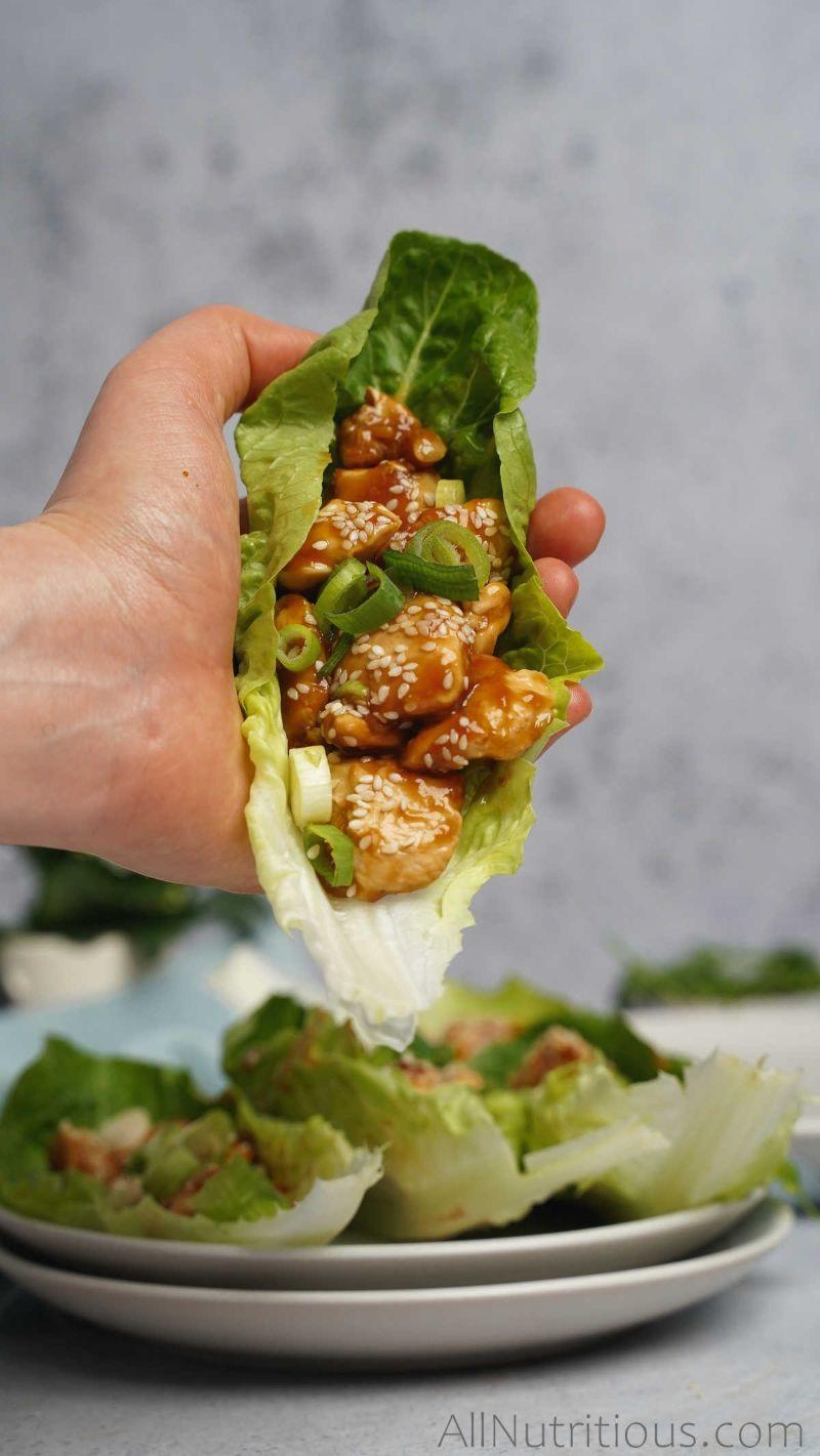 holding lettuce wrap