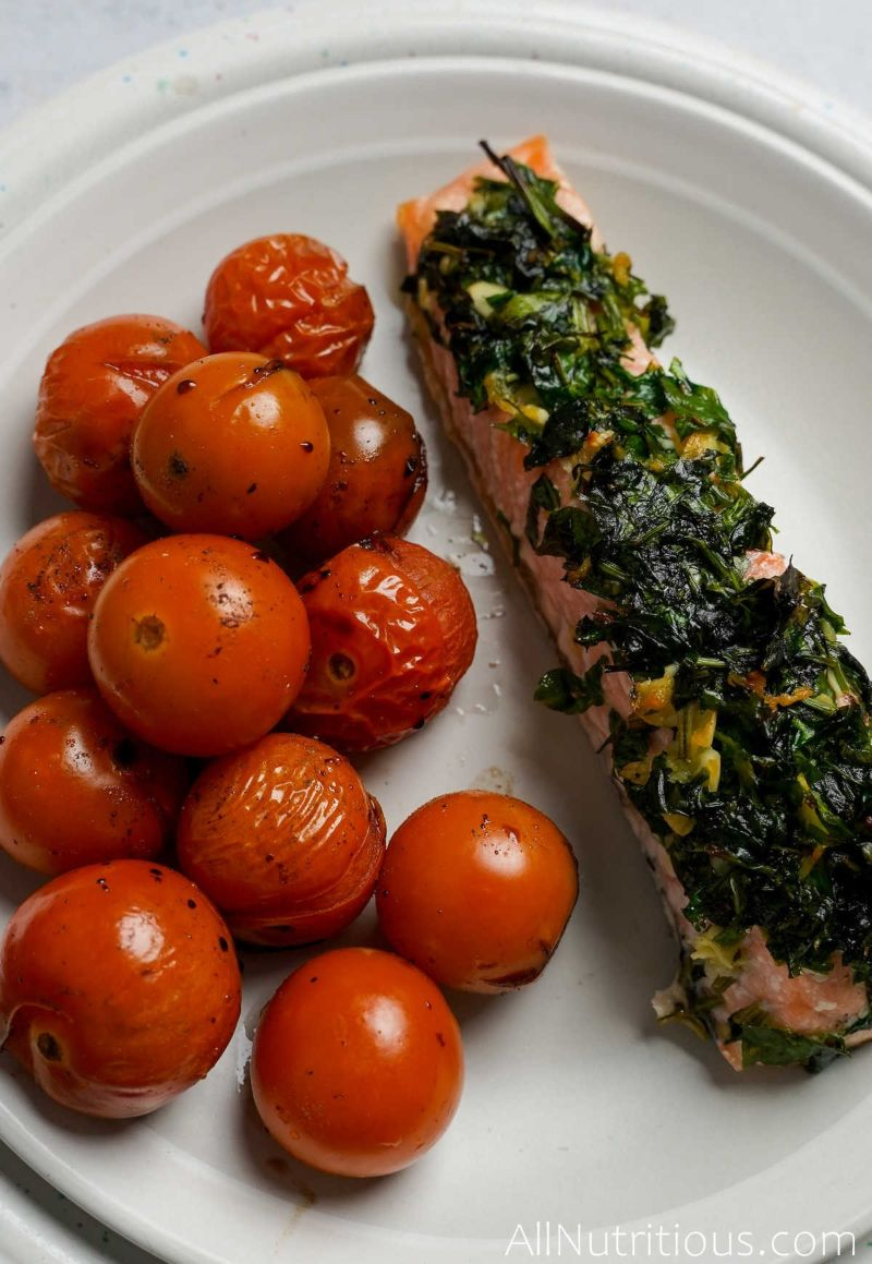 tomatoes on plate with herbed salmon