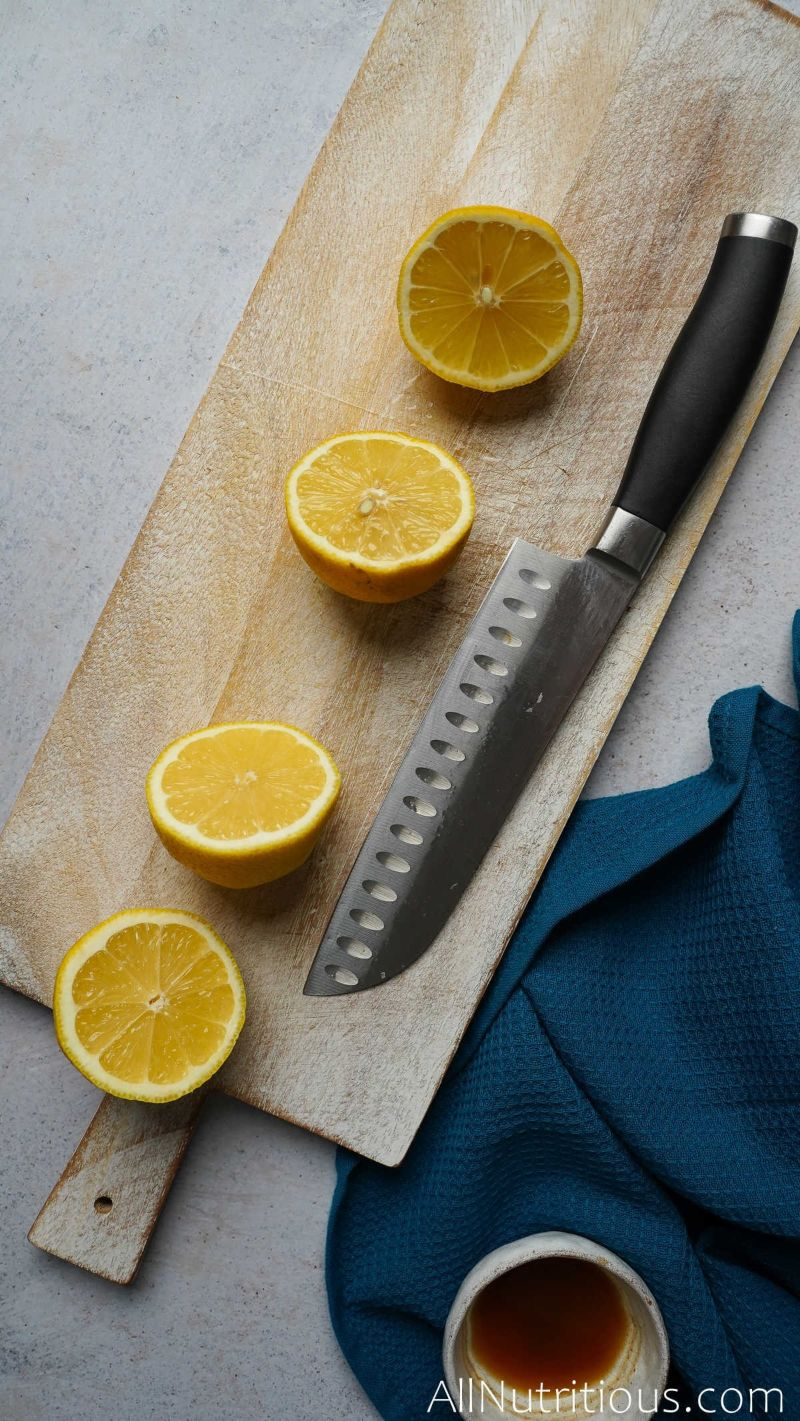 halved lemons on cutting board
