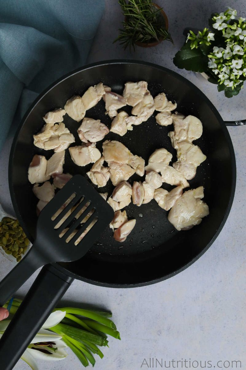 chicken cooking in pan
