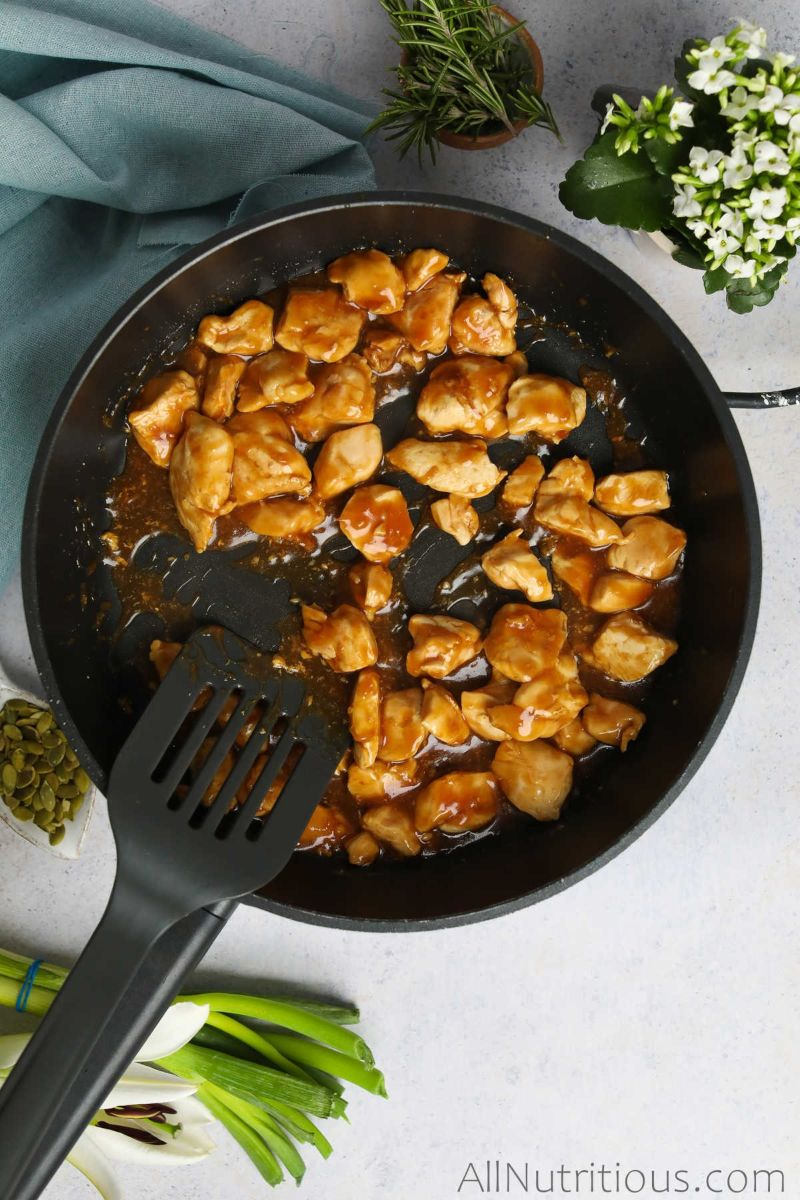 chicken coated with sauce in pan