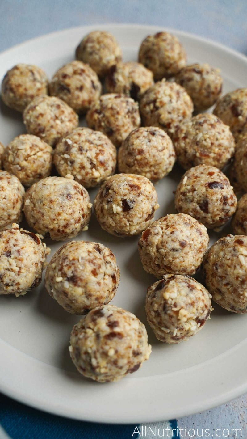 plate full of rolled cashew balls